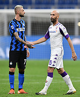 26th September 2020, San Siro Stadium, Milan, Italy; Serie A Football, Inter Milan versus Fiorentina;  Borja Valero shakes hands with Marcelo Brozovic