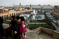 A father embraces his daughter on the walls of the Citadel overlooking Shar Park in Erbil on Friday afternoon.