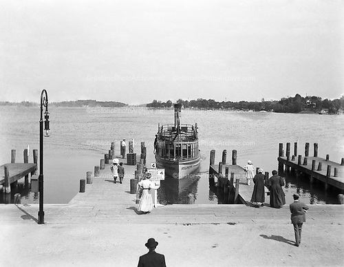"0012-1 Ferry dock on Lake Minnetonka, near Minneapolis, Minnesota. The ""Stillwater"" is taking on passengers for Wayzata, Fairview, Lynnwood, Summerville, Cottagewood, Deephaven, Wayzata. ca. 1906."