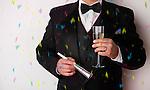 USA, Illinois, Metamora, Man with tuxedo holding champagne at party