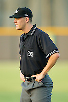 Umpire Travis Eggert handles the calls on the bases during an Appalachian League game between the Bristol White Sox and the Burlington Royals at Burlington Athletic Stadium August 13, 2010, in Burlington, North Carolina.  Photo by Brian Westerholt / Four Seam Images
