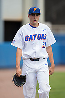 Florida Gators starting pitcher Alex Faedo (21) walks in from the bullpen prior to the game against the Wake Forest Demon Deacons in Game One of the Gainesville Super Regional of the 2017 College World Series at Alfred McKethan Stadium at Perry Field on June 10, 2017 in Gainesville, Florida.  (Brian Westerholt/Four Seam Images)