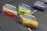Feb 22, 2009; Fontana, CA, USA; NASCAR Sprint Cup Series driver Clint Bowyer (33) leads Marcos Ambrose and Mark Martin during the Auto Club 500 at Auto Club Speedway. Mandatory Credit: Mark J. Rebilas-