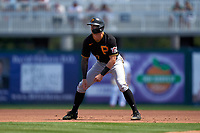 Pittsburgh Pirates Kevin Newman (27) leads off first base during a Major League Spring Training game against the Minnesota Twins on March 16, 2021 at Hammond Stadium in Fort Myers, Florida.  (Mike Janes/Four Seam Images)
