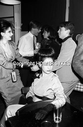 Blitz Kids New Romantics at The Blitz Club Covent Garden, London, England 1980. Princess Julia far left dancing with handbag/dancing with David Holah. Lesley Chilkes seated.