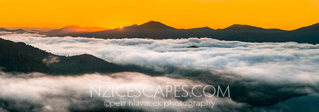 Sunrise over Queen Charlotte Sound covered under fog in Marlborough Sounds, Nelson Region, Marlborough, South Island, New Zealand