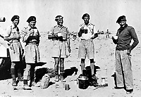 BNPS.co.uk (01202 558833)<br /> Pic: TheTankMuseum/BNPS<br /> <br /> Pictured: Field Marshal Bernard Montgomery (first from right) during the North African campaign.<br /> <br /> A fascinating letter by Field Marshal Bernard Montgomery expressing how he 'thoroughly enjoyed' facing the Desert Fox in battle has emerged 79 years on.<br /> <br /> The British army commander was pitted against the redoubtable Erwin Rommel during the North African desert campaign of 1942.<br /> <br /> The hand-written two page letter, dated October 6, 1942, was penned to his brother Harold while he was preparing for the decisive Battle of El Alamein, which turned the tide in World War Two.