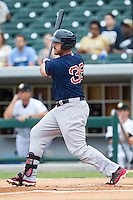 Travis Shaw (39) of the Pawtucket Red Sox follows through on his swing against the Charlotte Knights at BB&T Ballpark on August 10, 2014 in Charlotte, North Carolina.  The Red Sox defeated the Knights  6-4.  (Brian Westerholt/Four Seam Images)