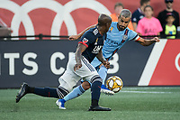 FOXBOROUGH, MA - SEPTEMBER 29: Luis Caicedo #27 of New England Revolution pressures Maximiliano Moralez #10 of New York City FC during a game between New York City FC and New England Revolution at Gillettes Stadium on September 29, 2019 in Foxborough, Massachusetts.