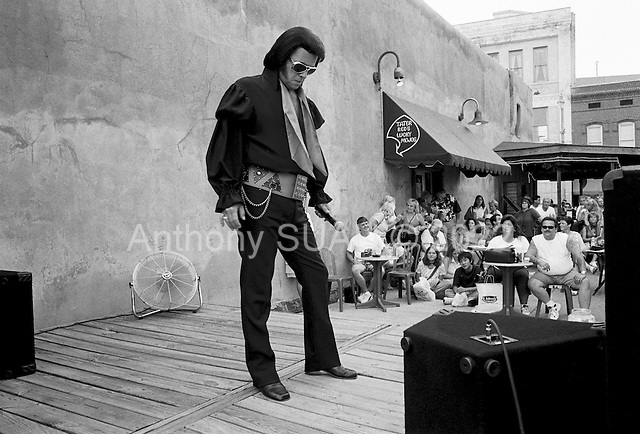 Memphis, Tennessee<br /> USA<br /> August 11, 2002<br /> <br /> An Elvis impersonator performs in a cafe just off Beale street to honor the 25 year anniversary of Elvis Persley's death.