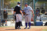 New York University Violets head coach Doug Kimbler (19) argues the ejection of first baseman Colman Hendershot (not shown) with the home plate umpire as Edgewood Eagles head coach Al Brisack  looks on during a game on March 14, 2017 at Terry Park in Fort Myers, Florida.  NYU defeated Edgewood 12-7.  (Mike Janes/Four Seam Images)