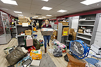 Pictured: Retail manager Karen Perry moves boxes of stock out of Hoperscue charity shop in Taff Street, Pontypridd. Wednesday 04 March 2020<br /> Re: Revisiting the flood affected areas in Pontypridd, Wales, UK.