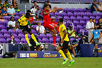 July 16th 2021; Orlando, Florida, USA; Jamaica defender Kemar Lawrence heads the ball clear during the Concacaf Gold Cup match between Guadeloupe and Jamaica on July 16, 2021 at Exploria Stadium in Orlando, Fl.