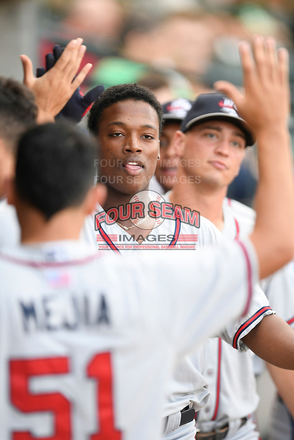 Center fielder Jeremy Fernandez (12) of the Rome Braves is greeted after scoring a run in a game against the Columbia Fireflies on Tuesday, June 4, 2019, at Segra Park in Columbia, South Carolina. Columbia won, 3-2. (Tom Priddy/Four Seam Images)
