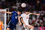 Sardar Azmoun of Iran (R) fights for the ball with Tomiyasu Takehiro of Japan (L) during the AFC Asian Cup UAE 2019 Semi Finals match between I.R. Iran (IRN) and Japan (JPN) at Hazza Bin Zayed Stadium  on 28 January 2019 in Al Alin, United Arab Emirates. Photo by Marcio Rodrigo Machado / Power Sport Images