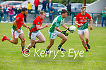 Kevin Goulding of Ballyduff in possession as Emmet Curran and team mate Sean O'Sullivan of St Michaels Foilmore  gives chase in the County Senior football league.
