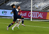 KANSAS CITY, KS - OCTOBER 24: #26 Jaylin Lindsey of Sporting Kansas City and #4 Danny Wilson of the Colorado Rapids battle for the ball in the box during a game between Colorado Rapids and Sporting Kansas City at Children's Mercy Park on October 24, 2020 in Kansas City, Kansas.