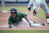Great Lakes Loons shortstop Errol Robinson (8) slides head first into third base against the Bowling Green Hot Rods during the Midwest League baseball game on June 4, 2017 at Dow Diamond in Midland, Michigan. Great Lakes defeated Bowling Green 11-0. (Andrew Woolley/Four Seam Images)