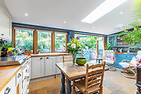 BNPS.co.uk (01202 558833)<br /> Pic: Strutt&Parker/BNPS<br /> <br /> Pictured: First floor Kitchen. <br /> <br /> An 18th century cottage in 'the prettiest village in England' is on the market for £675,000.<br /> <br /> Number 2 School Lane is Grade II listed, built with beautiful Cotswold stone and filled with character features like exposed timber beams and original fireplaces.<br /> <br /> The attractive three-bedroom property is in the highly sought after Wiltshire village of Castle Combe.<br /> <br /> The quintessentially English village has been used regularly as a film location and the houses are mostly made with honey-coloured Cotswold stone.