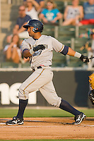 Zoilo Almonte #7 of the Charleston RiverDogs follows through on his swing against the Kannapolis Intimidators at Fieldcrest Cannon Stadium May 29, 2010, in Kannapolis, North Carolina.  Photo by Brian Westerholt / Four Seam Images