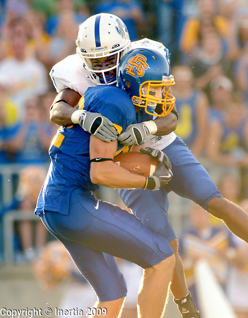 BROOKINGS, SD - SEPTEMBER 19: SDSU receiver Mike Steffen #82 out leaped Larry Carter #8 of Indiana State for a reception Saturday in their matchup in Brookings.  (Photo by Craig Johnson/Inertia)