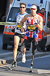 """Richard Whitehead of Great Britain (#42) on his way to establish a stunning PB of 2h56'45"""" competing in the 15th Rome Marathon on March 22, 2009 in Rome, Italy. Richard is a paralympic athlete running with special carbon fiber prothesis."""