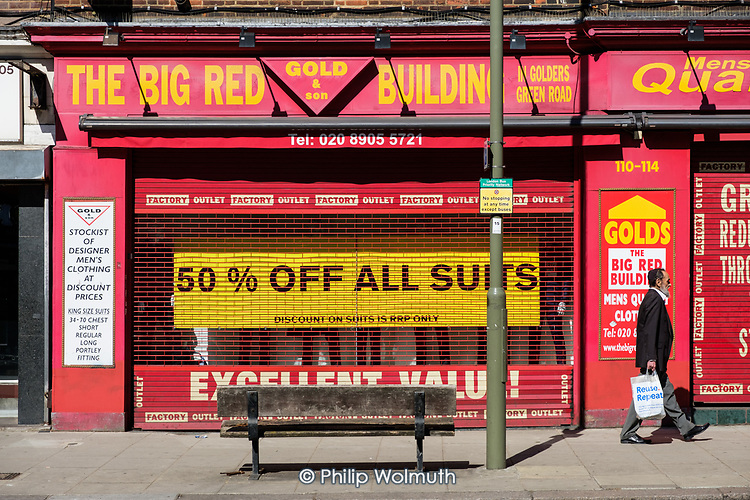 Covid-19 pandemic. Closed and boarded up clothing store, Golders Green, London.