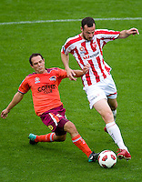 MELBOURNE, AUSTRALIA - NOVEMBER 14: Gerald Sibon of the Heart and Massimo Murdocca of the Roar compete for the ball during the round 14 A-League match between the Melbourne Heart and Brisbane Roar at AAMI Park on November 14, 2010 in Melbourne, Australia (Photo by Sydney Low / Asterisk Images)