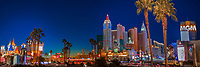 Colorful twilight panorama on the New York, New York, MGM and Excalibur casinos, with lit-up palm trees in the foreground, Las Vegas Nevada
