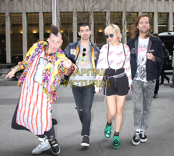 NEW YORK, NY - APRIL 14: Cole Whittle, Joe Jonas, JinJoo Lee and Jack Lawless of DNCE at SiriusXM Studios in New York City on April 14, 2017. <br /> CAP/MPI/RW<br /> ©RW/MPI/Capital Pictures