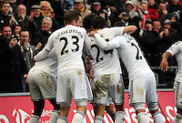SWANSEA, WALES - FEBRUARY 21: Jonjo Shelvey of Swansea celebrates his goal with team mates, making the score 2-1 to his team during the Barclays Premier League match between Swansea City and Manchester United at Liberty Stadium on February 21, 2015 in Swansea, Wales.