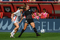 BRIDGEVIEW, IL - JULY 18: Kayla Sharples #28 of the Chicago Red Stars plays the ball as Bethany Balcer #24 of the OL Reign defends during a game between OL Reign and Chicago Red Stars at SeatGeek Stadium on July 18, 2021 in Bridgeview, Illinois.