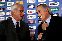 Il Commissario Tecnico della Nazionale italiana di calcio Marcello Lippi, a sinistra, arriva insieme al presidente della Federazione Italiana Giuoco Calcio (FIGC) Giancarlo Abete, per una conferenza stampa a Roma, 18 maggio 2010, per rendere nota la lista dei giocatori che prenderanno parte al raduno di Sestriere prima della partenza per i mondiali in Sudafrica..Italian national football team's manager Marcello Lippi, left, arrives with FIGC Italian Football Federation's president Giancarlo Abete for a press conference in Rome, 18 may 2010, to announce the list of players who will take part in a team's training scheduled from 23 may in Sestriere, Northern Italy, ahead of the South Africa World Cup..UPDATE IMAGES PRESS/Riccardo De Luca
