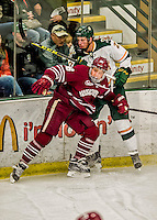 15 November 2015: University of Massachusetts Minuteman Forward Joseph Widmar, a Freshman from Northbrook, IL, checks University of Vermont Catamount Defenseman Ori Abramson, a Sophomore from Toronto, Ontario, at Gutterson Fieldhouse in Burlington, Vermont. The Minutemen rallied from a three goal deficit to tie the game 3-3 in their Hockey East matchup. Mandatory Credit: Ed Wolfstein Photo *** RAW (NEF) Image File Available ***