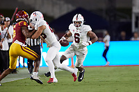 LOS ANGELES, CA - SEPTEMBER 11: Elijah Higgins #6 of the Stanford Cardinal runs with the ball after a pass reception during a game between University of Southern California and Stanford Football at Los Angeles Memorial Coliseum on September 11, 2021 in Los Angeles, California.