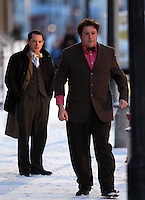 Pictured L-R: Elijah Wood with Celyn Jones rehearsing a scene. Tuesday 11 February 2014<br /> Re: A Swansea street was transformed into 1950s New York for new Dylan Thomas biopic 'Set Fire to the Stars' starring Holywood actor Elijah Wood.<br /> Gloucester Place in Swansea Marina was used to film a snowy scene in New York.<br /> Half a dozen 50s American cars were used for the scene played by Elijah Wood and Celyn Jones.<br /> The new movie will explore the fractious relationship between Dylan Thomas played by Jones and John Malcolm Brinnin played by WOod, who brought the Welshman to the USA and acted as his tour agent.