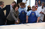Nevada First lady Kathleen Sandoval uses a sword to cut into a 1,300 pound cake at the Battle Born Birthday Cake Celebration at the Carson Tahoe Regional Medical Center, in Carson City, Nev., on Friday, March 21, 2014. From left are, Carson City Mayor Bob Crowell, Rep. Mark Amodei, volunteer coordinators Heidi Englund and Misti Gower and McAvoy Layne portraying Mark Twain. (Las Vegas Review-Journal/Cathleen Allison)