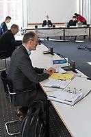 """Konstituierende Sitzung des Untersuchungsausschuss """"Gedenkstaette Hohenschoenhausen"""" des Berliner Abgeordnetenhaus.<br /> Der Untersuchungsausschuss wurde eingesetzt um sich """"mit moeglichen Ursachen, Konsequenzen und der Verantwortung fuer mutmassliche Fehlentwicklungen an der """"Gedenkstaette Berlin-Hohenschoenhausen"""" in der 17. und 18. Wahlperiode"""" zu befassen. Der damalige Leiter der Gedenkstaette, Hubertus Knabe, war 2019 entlassen worden, nachdem sich mehrere Mitarbeiterinnen ueber sexuell uebergriffiges Verhalten des Leiters und anderen Vorgesetzter oeffentlich geaeussert hatten.<br /> Im Bild: Der AfD-Abgeordnete Martin Trefzer. Trefzer hat trotz ausstehendem Corona-Testergebnis  noch an der Sitzung der Ausschusses teilgenommen. Kurz darauf ist der Test positiv beschieden worden. Die Ausschusskollegen sind entsetzt ueber dieses """"unkollegiale Verhalten"""".<br /> 24.3.2020, Berlin<br /> Copyright: Christian-Ditsch.de<br /> [NUR FUER REDAKTIONELLE ZWECKE! Werbung nur auf Anfrage beim Fotografen. Inhaltsveraendernde Manipulation des Fotos nur nach ausdruecklicher Genehmigung des Fotografen. Vereinbarungen ueber Abtretung von Persoenlichkeitsrechten/Model Release der abgebildeten Person/Personen liegen nicht vor. NO MODEL RELEASE! Don't publish without copyright Christian-Ditsch.de, Veroeffentlichung nur mit Fotografennennung, sowie gegen Honorar, MwSt. und Beleg. Konto: I N G - D i B a, IBAN DE58500105175400192269, BIC INGDDEFFXXX, Kontakt: post@christian-ditsch.de<br /> Bei der Bearbeitung der Dateiinformationen darf die Urheberkennzeichnung in den EXIF- und  IPTC-Daten nicht entfernt werden, diese sind in digitalen Medien nach §95c UrhG rechtlich geschuetzt. Der Urhebervermerk wird gemaess §13 UrhG verlangt.]"""
