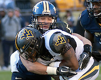 Pitt linebacker Max Gruder makes a tackle on WVU wide receiver Tavon Austin. The WVU Mountaineers defeated the Pitt Panthers 35-10 at Heinz Field, Pittsburgh, Pennsylvania on November 26, 2010.