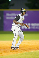 Kevin Jordan #21 (Wake Forest) of the Wilson Tobs takes his lead off of second base against the High Point-Thomasville HiToms at Finch Field on June 17, 2013 in Thomasville, North Carolina.  The Tobs defeated the HiToms 3-2 in 11 innings.  Brian Westerholt/Four Seam Images