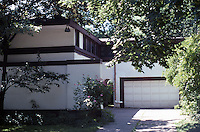 F.L. Wright: Davidson House, Buffalo. West side of house from street. Banded windows over garage.  Photo '88.