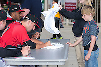 Kannapolis Intimidators pitcher Ryan Hinchley (17) signs an autograph for a young fan prior to the game against the Hickory Crawdads at Kannapolis Intimidators Stadium on April 10, 2016 in Kannapolis, North Carolina.  The Intimidators defeated the Crawdads 10-3.  (Brian Westerholt/Four Seam Images)