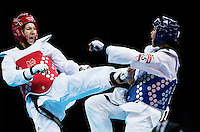 10 AUG 2012 - LONDON, GBR - Sarah Stevenson (GBR) (left) of Great Britain aims a kick at Paige McPherson of the USA during their women's -67kg category contest London 2012 Olympic Games Taekwondo at Excel in London, Great Britain .(PHOTO (C) 2012 NIGEL FARROW)