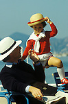 French father and son enjoying quality time together in the sun. South of France.They are looking very chic and typically stylish. 1980