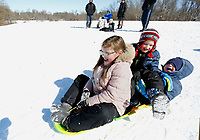 Avery Garrison, 8, (left) sleds Tuesday, February 16, 2021, with her twin brothers Bentley and Brooks, both 5, down a hill at J.B. Hunt Park in Springdale. Temperatures dipped to 20 degrees below zero in some parts of the region over night Monday. Check out nwaonline.com/210217Daily/ and nwadg.com/photos for a photo gallery.<br /> (NWA Democrat-Gazette/David Gottschalk)