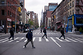 April 21, 2020<br /> New York, New York<br /> <br /> Heading to work on 29th Street and Lexington Avenue in Manhattan just after sunrise at the height of the coronavirus pandemic.