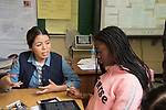 Education HIgh School female teacher working with female student in class, discussing work