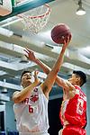 Leung Shiu Wah #6 of South China Athletic Association Men's Basketball Team (L) tries to score next to Ng Ka Hin #15 of Nam Ching Basketball Team (R) during the Hong Kong Basketball League game between SCAA and Nam Ching at Southorn Stadium on May 4, 2018 in Hong Kong. Photo by Yu Chun Christopher Wong / Power Sport Images