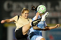 Rachel Buehler (4) of FC Gold Pride clears the ball away from Natasha Kai (6) of Sky Blue FC. Sky Blue FC and FC Gold Pride played to a 1-1 tie during a Women's Professional Soccer match at TD Bank Ballpark in Bridgewater, NJ, on April 11, 2009. Photo by Howard C. Smith/isiphotos.com