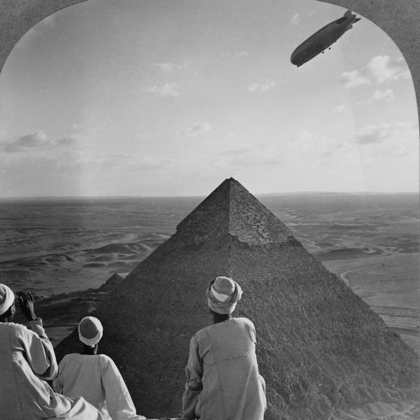 """Original Stereoscope caption """"The Graf Zeppelin's Rendezvous with the Eternal Desert and the More than 4,000 Year-old Pyramids of Gizeh, Egypt. Photo taken in 1931."""